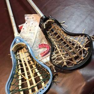 2 girls lacrosse sticks